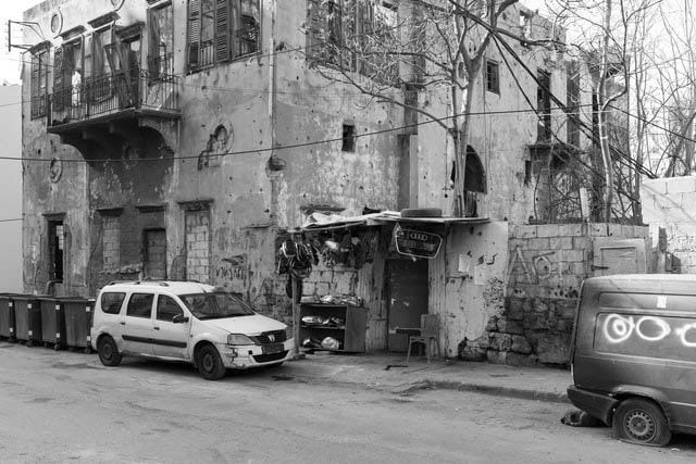 Bombed out street with parked, damaged vehicles in Lebanon