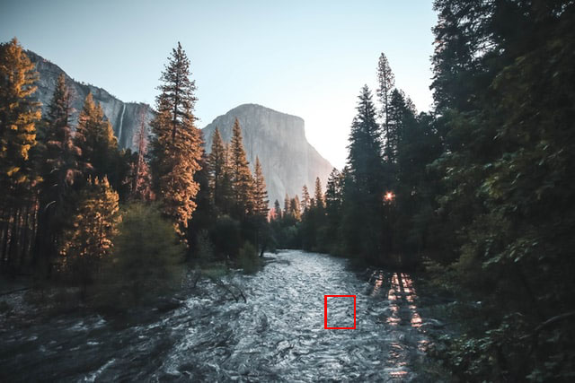Rushing river with a red square outline of a small part of it