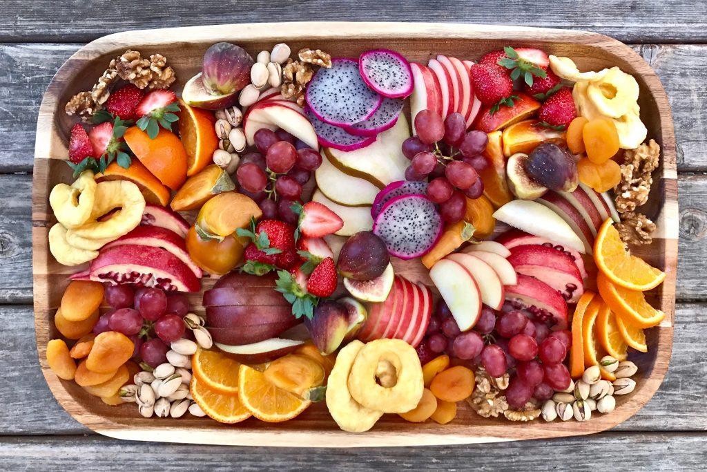 Plate of beautiful sliced fruit